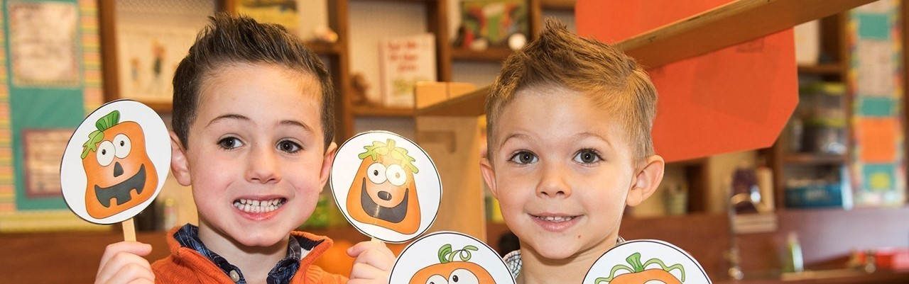 Two little boys with pumpkins