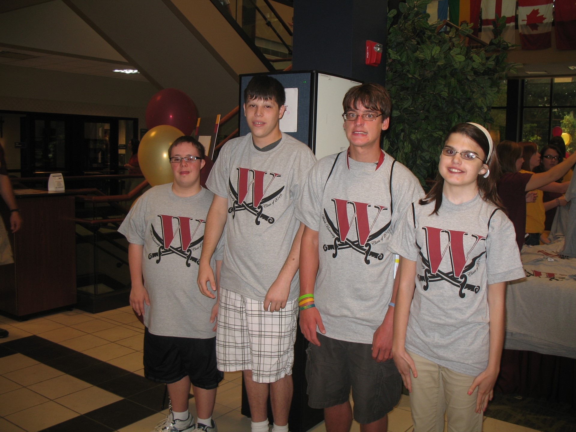Four Transition U Students in Walsh T-shirts