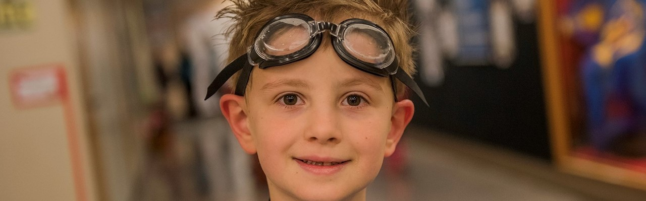 little boy with goggles