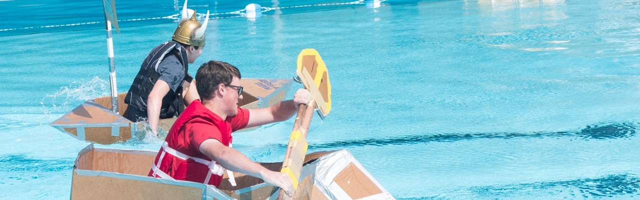 Students in cardboard boat race