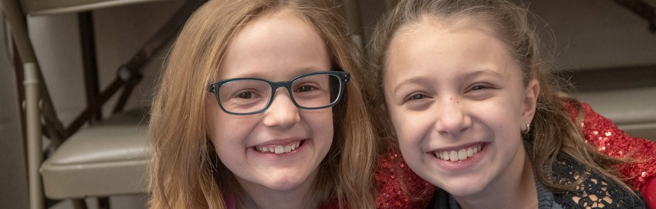 two smiling fifth-grade girls