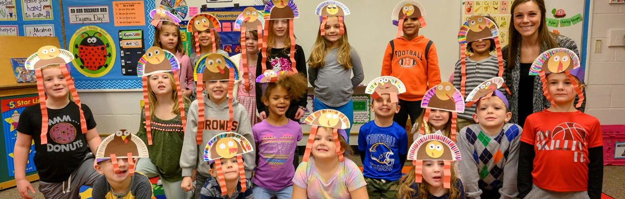 Kindergarten children with turkey hats