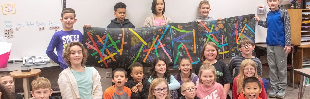 Classroom of fifth-grade students showing their finished art