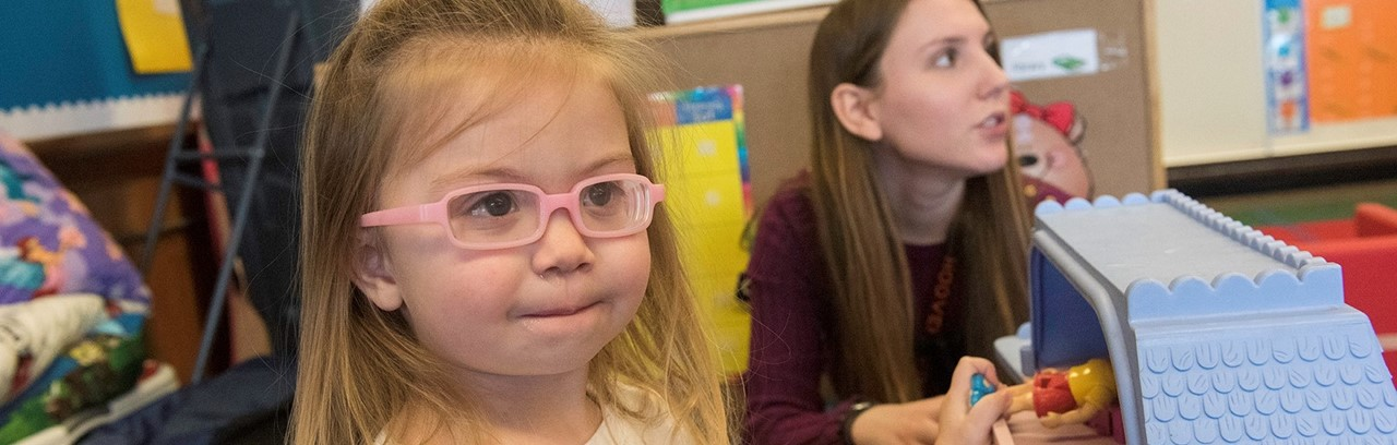 Little girl in pink glasses