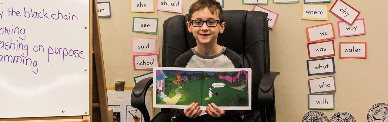 Student reading to other students