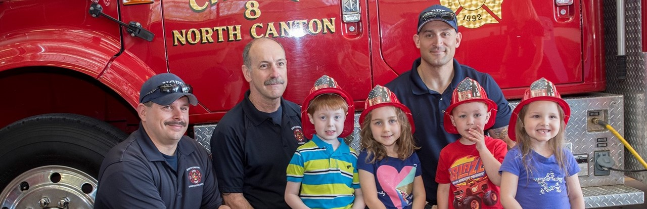 preschool students posed with three firemen