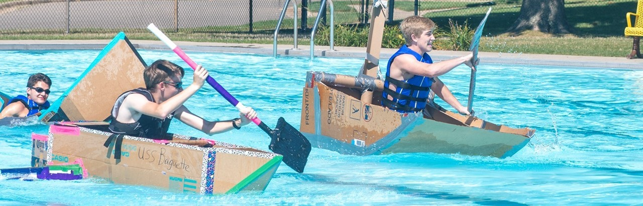 Engineering students racing their cardboard boats