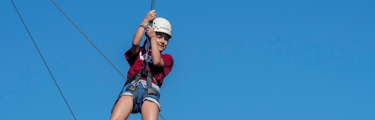 Middle school girl ziplining