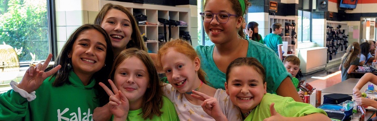 Six middle school girls wearing green
