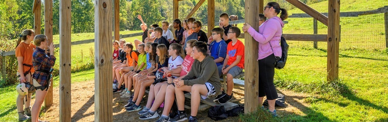 Sixth-grade students at camp receiving instruction