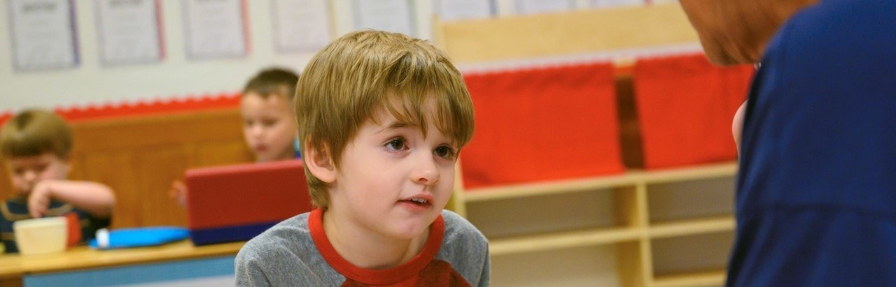 preschool boy in a red and gray shirt