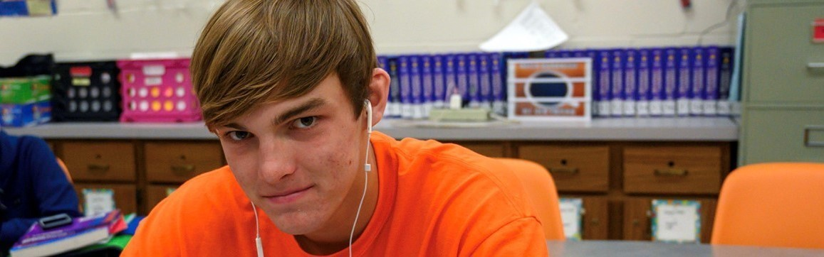 a high school boy wearing an orange t-shirt