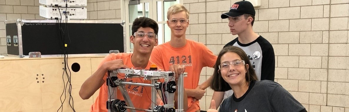 four robotics students