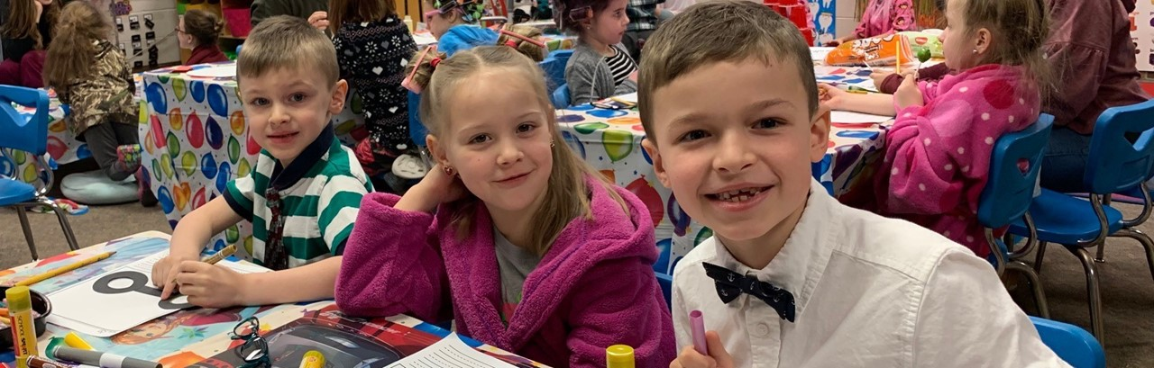 Two kindergarten boys and one girl dressed for the 100th day of school