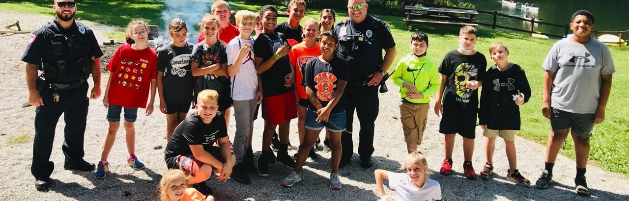 middle school students and police officers on beach
