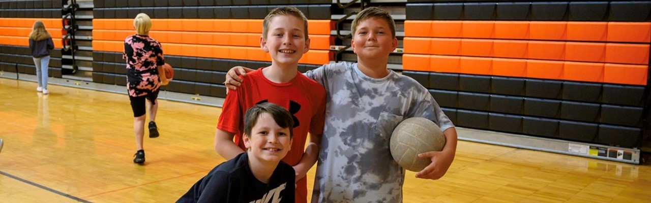 three boys with a volleyball