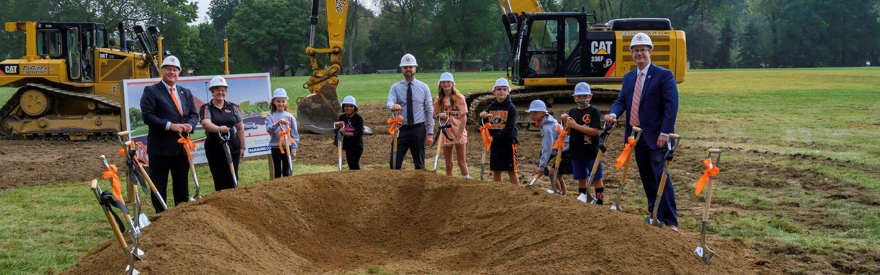 groundbreaking ceremony with people, kids and shovels